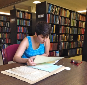 Kate E. Korth diving in to some archival research materials at the Burton Historical Collection