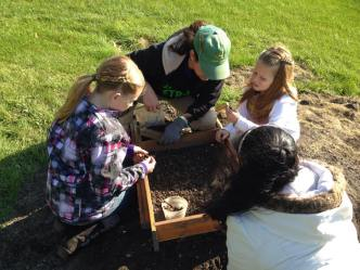 Friend of WSU Archaeology Kaitlin helps future archaeologist screen for finds.